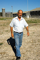 Former prison warder Christo Brand was one of the warders directly assigned to guard Nelson Mandela at Robben Island prison between 1978 and 1987, he was in charge of the educational studies of Nelson Mandela and a few other prisoners. Behind him is the Maximum Security section where Mandela and colleagues were held. The prison is now a museum and major tourist attraction..