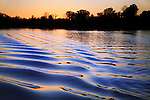 Ripples In The Wake Of A Pontoon Boat At Sunset On Whitewood Lake, Part Of The Huron River Chain Of Lakes, Southeastern Michigan, USA
