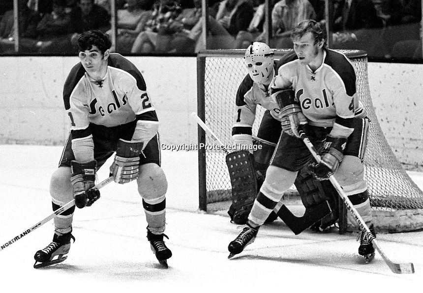 California Golden Seals Ron Stackhouse and Dick Redmond  help defend goalie Gary Smith..(1971 photo/Ron Riesterer)