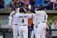 Pensacola Blue Wahoos Tanner English (4) celebrates with Jaylin Davis (5), Ernie De La Trinidad (hidden), Alex Kirilloff (19), and Travis Blankenhorn (32) after hitting a home run during a Southern League game against the Biloxi Shuckers on May 3, 2019 at Admiral Fetterman Field in Pensacola, Florida.  Pensacola defeated Biloxi 10-8.  (Mike Janes/Four Seam Images)