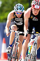 08 AUG 2010 - LONDON, GBR - Stuart Hayes follows Matthew Sharp during the Elite Mens race at the  2010 Challenger World London Triathlon (PHOTO (C) NIGEL FARROW)