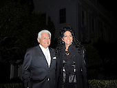 """Washington, DC - October 13, 2009 -- Performers Pete Escovedo (L) and Sheila E. attend a White House Music Series """"Fiesta Latina"""" on the South Lawn of the White House in Washington on Tuesday, October 13, 2009. .Credit: Alexis C. Glenn / Pool via CNP"""