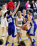 SIOUX FALLS, SD - February 13: Ellie Brecht #34 from Sioux Falls Lincoln is fouled while driving between Alexis Marsico #30 and Marissa Hirchert #52 from Rapid City Stevens in the first half of their game Friday night at the Denny Sanford Premier Center. (Photo by Dave Eggen/Inertia)
