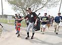 Ichiro Suzuki (Marlins),<br /> FEBRUARY 24, 2014 - MLB :<br /> Ichiro Suzuki of the Miami Marlins pat a young fan's head during the Miami Marlins spring training camp in Jupiter, Florida, United States. (Photo by AFLO)