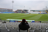 A spectator awaits the start of play during Yorkshire CCC vs Essex CCC, Specsavers County Championship Division 1 Cricket at Emerald Headingley Cricket Ground on 15th April 2018