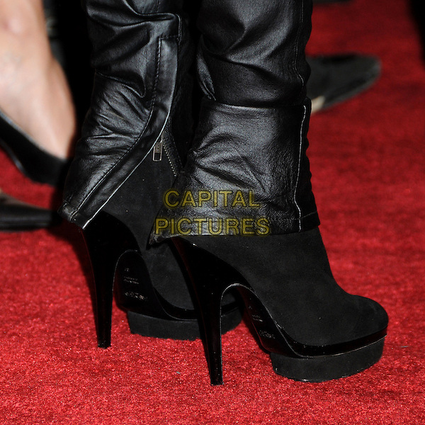 TARA REID's boots .House of Blues Haiti Fundraiser Benefit for Project We.The.Children. held at The House Of Blues, West Hollywood, California, USA, 28th January 2010..zips leather black heels platform shoes feet detail.CAP/ADM/BP.©Byron Purvis/AdMedia/Capital Pictures.