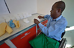 Sunny Nyamandwe folds bandages as part of his work at the National Rehabilitation Centre in Ruwa, Zimbabwe. The Centre assembles and fits wheelchairs provided by the Jairos Jiri Association with support from CBM-US, and Nyamandwe is one of the beneficiaries of the program. His legs remain paralyzed after an automobile accident more than two decades ago.
