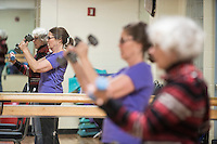 STAFF PHOTO ANTHONY REYES &bull; @NWATONYR<br /> Annette Williams, of Lowell, and Jean Greene, of Springdale, work out in the Strong Bodies program Tuesday, Dec. 23, 2014 at the Jones Center in Springdale. The program promotes fitness for seniors. The Jones Center will soon start a Silver Sneakers program, where seniors can qualify through their insurance for a free fitness membership.
