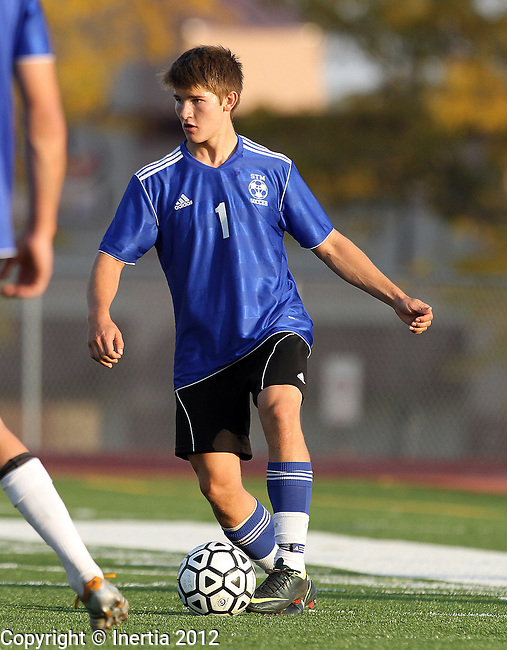 SIOUX FALLS, SD - SEPTEMBER 29: Landon Kudrna #1 from St. Thomas More looks for a teammate in their game against O'Gorman in the first half of their match Saturday evening at O'Gorman. (Photo by Dave Eggen/Inertia)