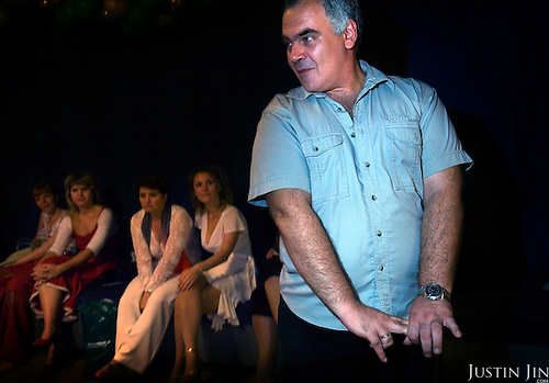 """Russian self-proclaimed master of seduction Vladimir Rakovsky teaches students to be """"real women"""". The course, given in Moscow, includes seduction theory, posture and strip-tease. The course, also dubbed """"How to Marry a Millionaire"""", teaches women to be subservient to men. The course takes place at the Dubrovka Theatre, scene of the terrorist siege."""