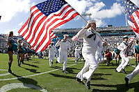 November 08, 2009:    Active Navy personnel lead the Jaguars on the field during Military Appreciation Day prior to the start of action  between the AFC West  Kansas City Chiefs and AFC South Jacksonville Jaguars at Jacksonville Municipal Stadium in Jacksonville, Florida............