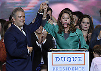 BOGOTA - COLOMBIA, 17-06-2018: Ivan Duque, presidente electo y candidato presidencial por el partido Centro Democrático, acompañado de su vicepresidente, Martha Lucia Ramirez, durante su alocución al finalizar la segunda vuelta de las elecciones presidenciales de Colombia 2018 hoy domingo 17 de junio de 2018. El candidato ganador gobernará por un periodo máximo de 4 años fijado entre el 7 de agosto de 2018 y el 7 de agosto de 2022. / Ivan Duque, elected president and presidential candidate for the Centro Democratico party, and his vice president, Martha Lucia Ramirez, during his speech after Colombia's second round of 2018 presidential election today Sunday, June 17, 2018. The winning candidate will govern for a maximum period of 4 years fixed between August 7, 2018 and August 7, 2022. Photo: VizzorImage / Gabriel Aponte / Staff