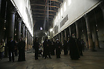 Christians gather inside the Church of Nativity, traditionally believed by Christians to be the birthplace of Jesus Christ, in the West Bank town of Bethlehem, Thursday, Dec. 24, 2009. Photo by Mohamar Awad