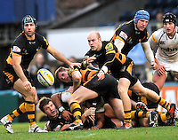 High Wycombe, England. Joe Simpson of London Wasps clears the ball during the Aviva Premiership match between London Wasps and Sale Sharks at Adams Park on December 23. 2012 in High Wycombe, England.