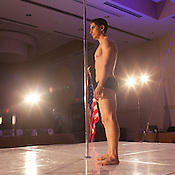 Alfie Sosa stands on stage during the warm up period before his performance at the 2014 Atlantic Pole Championships in Herndon, Va. on April 12, 2014. Mr. Sosa went on to win the Championship Men's Professional Division. CREDIT: Lance Rosenfield/Prime for The Washington Post