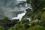 Iguazu Falls National Park in Argentina.  A UNESCO World Heritage Site.  Pictured is San Martin in the center through the tropical rainforest, with a stone arch or window by the Hidden Falls or Salto Escondido.