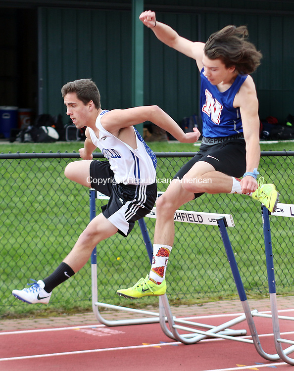 LITCHFIELD CT. 09 May 2017-050917SV08-#12 From left, Caleb Canfield of Litchfield High and Aiden Leonard of Nonnewaug High compete in the 110 hurdles during a track meet in Litchfield Tuesday. <br /> Steven Valenti Republican-American