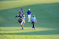 Mike Lorenzo-Vera (FRA) & Tommy Fleetwood (ENG) on the 18th fairway during the third round of the DP World Championship, Earth Course, Jumeirah Golf Estates, Dubai, UAE. 23/11/2019<br /> Picture: Golffile | Phil INGLIS<br /> <br /> <br /> All photo usage must carry mandatory copyright credit (© Golffile | Phil INGLIS)