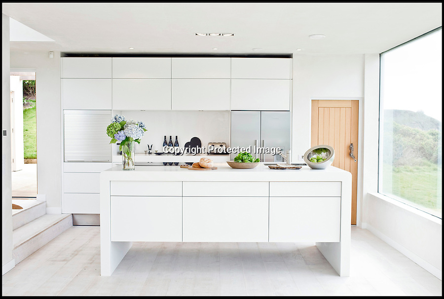 BNPS.co.uk (01202 558833)<br /> Pic: ForeverCornwall/BNPS<br /> <br /> ****Must use full byline****<br /> <br /> The kitchen.<br /> <br /> When a couple paid out £500,000 for a tumbledown cottage that was fit for nothing but demolition, a few eyebrows were raised among their friends.<br /> <br /> But Alex Michaelis and Susanna Bell's gamble to buy the cliff-top property that had no central heating or electricity has paid off after they turned it into a stunning holiday home now worth three times the purchase price.<br /> <br /> Architect Alex made the most of the stunning views enjoyed from the plot and has ensured all main rooms of the new house, including the four bedrooms and five bathrooms, face the sea.<br /> <br /> They now rent out the modern seaside home overlooking Praa Sands, near Penzance, Cornwall for as much as £5,000 a week.