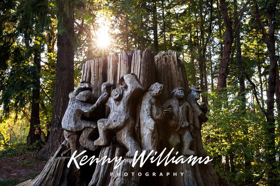 """Wobblies Dancing"" old growth cedar stump carving by Northwest artist and sculptor Richard Beye, Dottie Harper Park, Burien, Washington State, WA, America, USA."