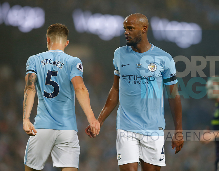 John Stones of Manchester City and Vincent Kompany of Manchester City during the Premier League match at the Eithad Stadium, Manchester. Picture date 21st August 2017. Picture credit should read: Simon Bellis/Sportimage