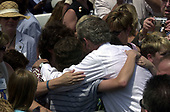 Washington, DC - May 15, 2004 -- United States President George W. Bush shares a group hug with families following his remarks at the Annual Peace Officers' Memorial Service on the West Lawn of the United States Capitol in Washington, D.C. on May 15, 2004.  The service, sponsored by the Fraternal Order of Police (FOP), is held annually on May 15 to honor those who gave their lives during the previous year and to honor their families.  The service remembers the sacrifice of the more than 15,000 officers who have been killed in the line of duty since 1794.<br /> Credit: Ron Sachs / CNP<br /> (RESTRICTION: NO New York or New Jersey Newspapers or newspapers within a 75 mile radius of New York City)