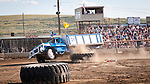 Pickup and vintage grain truck racing on the dirt track in the arena during 24th Lind Combine Destruction Derby, Washington. Sponsored by the Lind, Wash., Lions Club.