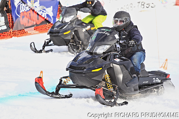 Quebec, Canada 4/7/2018.  Snowmobile uphill drag race held on the slopes of Val Saint-Come ski resort