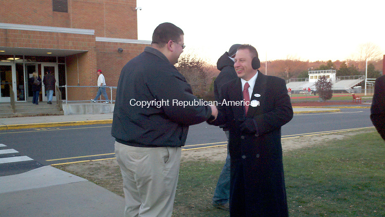 State Sen. Rob Sampson, R-Wolcott, shakes hands with a voter outside Wolcott High School Tuesday afternoon. He is running for a second term in the 80th House District, which includes Wolcott and part of Southington.  Drew Larson Republican-American
