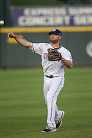 Round Rock Express third baseman Kevin Kouzmanoff #3 warms up before the Pacific Coast League baseball game against the Oklahoma City Redhawks on April 3, 2014 at the Dell Diamond in Round Rock, Texas. The Redhawks defeated the Express 7-6 in the season opener for both teams. (Andrew Woolley/Four Seam Images)