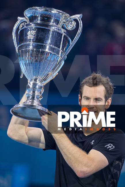 Andy Murray lifts the ATP world number one trophy during the Barclays ATP World Tour Finals FINAL match between ANDY MURRAY and NOVAK DJOKOVIC at the O2, London, England on 20 November 2016. Photo by Andy Rowland.