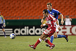Aug 22 2007:  Cuauhtemoc Blanco (10) of the FIre passes the ball as Jimmy Conrad (behind) applies pressure.  The MLS Kansas City Wizards defeated the visiting Chicago Fire 3-2 at Arrowhead Stadium in Kansas City, Missouri, in a regular season league soccer match.