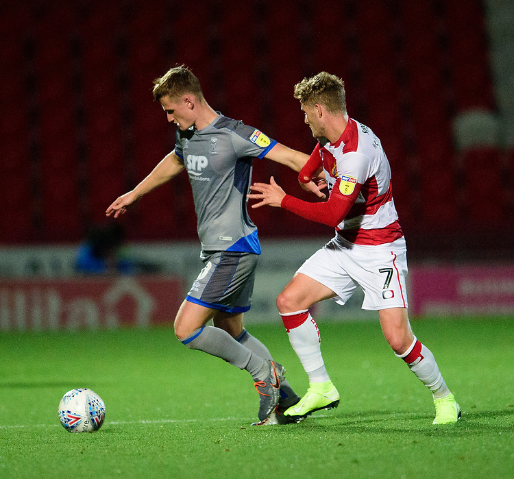 Lincoln City's Callum Connolly shields the ball from  Doncaster Rovers' Kieran Sadlier<br /> <br /> Photographer Andrew Vaughan/CameraSport<br /> <br /> EFL Leasing.com Trophy - Northern Section - Group H - Doncaster Rovers v Lincoln City - Tuesday 3rd September 2019 - Keepmoat Stadium - Doncaster<br />  <br /> World Copyright © 2018 CameraSport. All rights reserved. 43 Linden Ave. Countesthorpe. Leicester. England. LE8 5PG - Tel: +44 (0) 116 277 4147 - admin@camerasport.com - www.camerasport.com