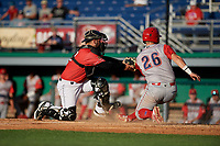 Batavia Muckdogs catcher Michael Hernandez (29) tags Rudy Rott (26) sliding home during a NY-Penn League game against the Williamsport Crosscutters on August 25, 2019 at Dwyer Stadium in Batavia, New York.  Williamsport defeated Batavia 10-3.  (Mike Janes/Four Seam Images)