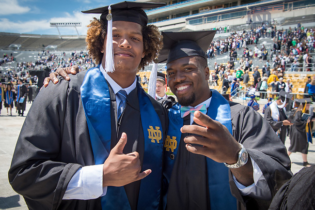 May 21, 2017; Former football players Isaac Rochelle and Malik Zaire at Commencement 2017. (Photo by Matt Cashore/University of Notre Dame)