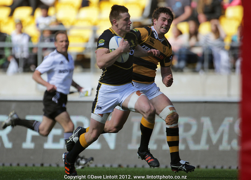 Jason Woodward beats Kurt Baker to the ball and heads for the tryline during the ITM Cup rugby union match between Wellington Lions and Taranaki at Westpac Stadium, Wellington, New Zealand on Sunday, 14 October 2012. Photo: Dave Lintott / lintottphoto.co.nz