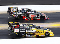Sep 15, 2013; Charlotte, NC, USA; NHRA funny car driver Matt Hagan (far lane) races alongside Jeff Arend during the Carolina Nationals at zMax Dragway. Mandatory Credit: Mark J. Rebilas-