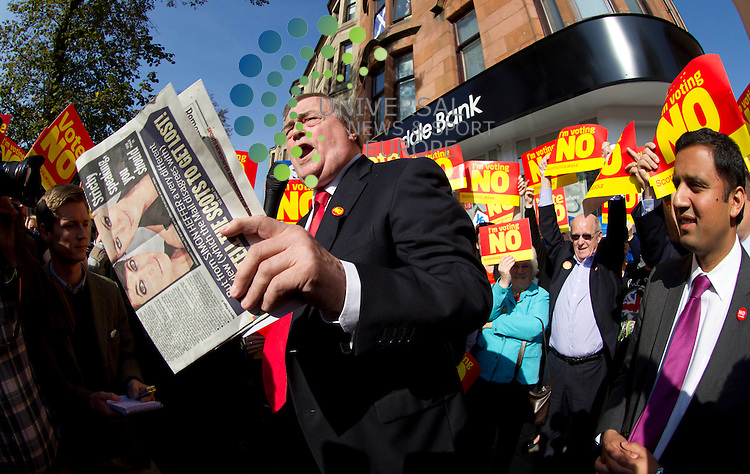 John Prescott holds a copy of the Daily Mail Newspaper with the headline &quot; Don't Rip Our Family Apart&quot; with Anas Sarwar on referendum campaign. The Labour veteran was joined by Alistair Darling and Anas Sarwar all making stump speeches and campaign call's with local Labour activists.<br /> Picture: Universal News And Sport (Scotland) 10 September 2014.
