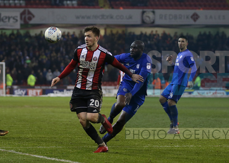 Lee Evans of Sheffield Utd tackled by Sol Bamba of Cardiff City during the Championship match at Bramall Lane Stadium, Sheffield. Picture date 02nd April, 2018. Picture credit should read: Simon Bellis/Sportimage
