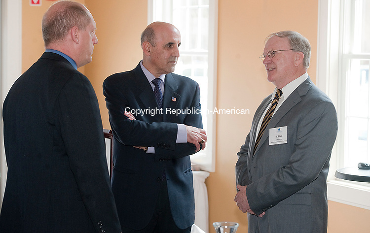 WATERBURY, CT-041117JS04- Bill Berger. Business Development Manager at Ward Leonard Electric Co., Inc., left, and Selim Noujaim of Noujaim Tool Company, Inc., center, talks with T. Blair Decker, right, vice president of supply chain, metal conveyance and strategic sourcing for General Dynamics Electric Boat Corp., during a seminar hosted by the Waterbury Regional Chamber, Wednesday at Vassi's Restaurant in Waterbury.  <br /> Jim Shannon Republican-American
