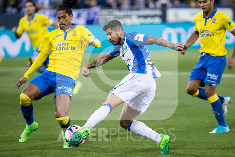 Mauricio Lemos competes for the ball with Miguel Angel Guerrero of Club Deportivo Leganes during the match of La Liga between Deportivo Leganes and Union Deportiva Las Palmas  Butarque Stadium  in Madrid, Spain. April 25, 2017. (ALTERPHOTOS/Rodrigo Jimenez)
