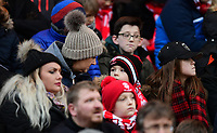 Lincoln City fans watch their team in action<br /> <br /> Photographer Chris Vaughan/CameraSport<br /> <br /> The EFL Sky Bet League Two - Lincoln City v Notts County - Saturday 13th January 2018 - Sincil Bank - Lincoln<br /> <br /> World Copyright &copy; 2018 CameraSport. All rights reserved. 43 Linden Ave. Countesthorpe. Leicester. England. LE8 5PG - Tel: +44 (0) 116 277 4147 - admin@camerasport.com - www.camerasport.com