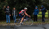26 SEP 2010 - CLACTON, GBR - Spectators shelter from the heavy rain during the cycle at the Clacton Standard Distance Triathlon (PHOTO (C) NIGEL FARROW)