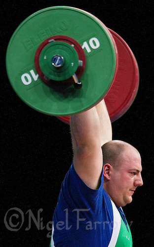 11 DEC 2011 - LONDON, GBR - Peter Nagy (HUN) lifts during the men's +105kg category Clean and Jerk of the London International Weightlifting Invitational and 2012 Olympic Games test event held at the ExCel Exhibition Centre in London, Great Britain .(PHOTO (C) NIGEL FARROW)