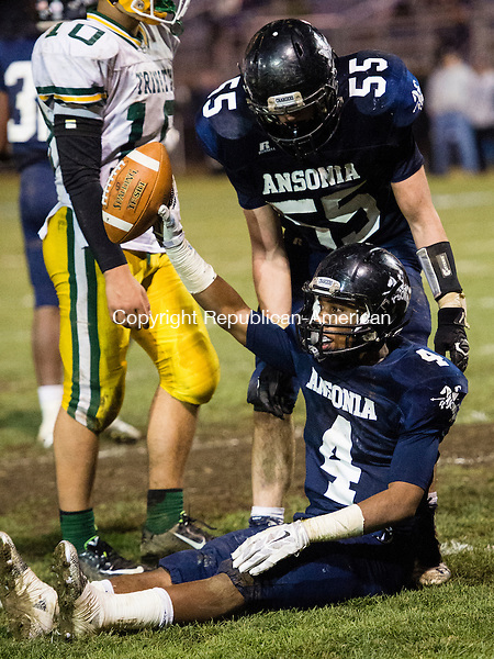 ANSONIA, CT - 7 December 2015-120715EC07-- Ansonia's Tajik Bagley sits in Trinity Catholic's end zone Monday night at Ansonia. There was no touchdown, officials ruled a time out was called before the snap. Erin Covey Republican-American.