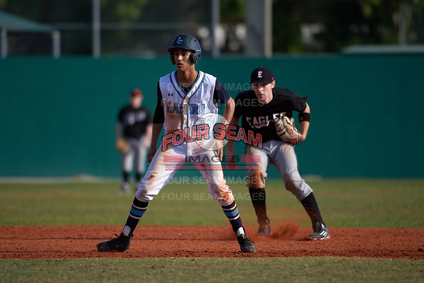 Lasell Lasers Evan Michalek (26) leads off second base in front of shortstop Jonathan Roehler (9) during the first game of a doubleheader against the Edgewood Eagles on March 14, 2016 at Terry Park in Fort Myers, Florida.  Edgewood defeated Lasell 9-7.  (Mike Janes/Four Seam Images)