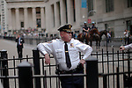 A NYPD Police officer escort a weekly march called by every friday on Wall Street in New York, United States. 23/03/2012. Photo by Kena Betancur / VIEWpress.