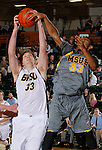 SPEARFISH, S.D. -- NOVEMBER 16, 2013 -- Marc Matthews #33 (right) of Montana State - Billings gets a hand on a shot by Mitchell Foth #33 of Black Hills State during their game Saturday at the Donald E. Young Center in Spearfish, S.D. (Photo by Dick Carlson/Inertia)