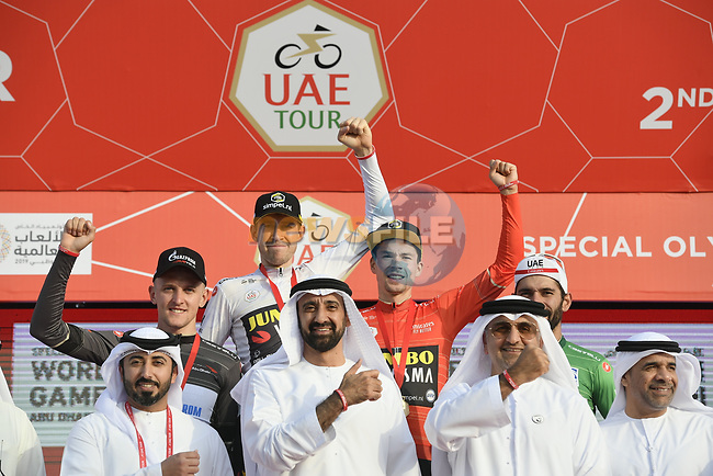 The jersey holders on the podium at the end of Stage 2 of the 2019 UAE Tour, running 184km form Yas Island Yas Mall to Abu Dhabi Breakwater Big Flag, Abu Dhabi, United Arab Emirates. 25th February 2019.<br /> Picture: LaPresse/Fabio Ferrari | Cyclefile<br /> <br /> <br /> All photos usage must carry mandatory copyright credit (© Cyclefile | LaPresse/Fabio Ferrari)