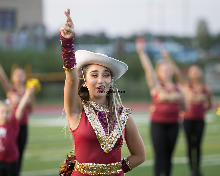 The Rouse High School cheer and dance teams take the field ahead of a high school football game between the Rouse Raiders and the East View Patriots at A.C. Bible Stadium in Leander, Texas, on Friday, September 15, 2017.